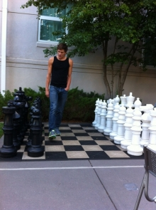 Fellow CRP Resident Triathlete Alex Willis setting up the giant chess board