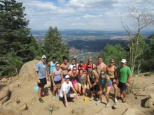 The whole group at the summit of the Incline! You can see Colorado Springs in the background