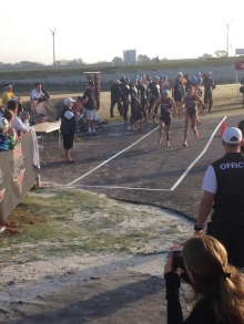 Handing off to Alan Webb in the exchange zone of the Mixed Team Relay
